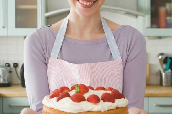 woman-holding-a-cake-pic-getty-images-597720498-600x399